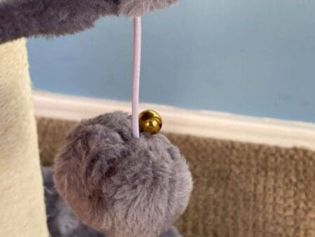 Kitty Cat Post Features a Pom Pom Ball